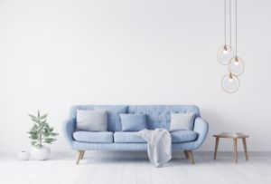pale blue walls of a living room with a pale blue couch