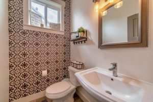a bathroom with an accent wall